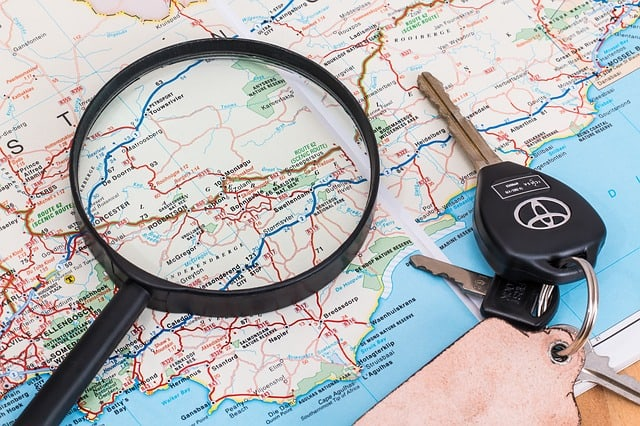 Magnifying glass and keys on a map